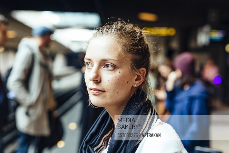 Thoughtful businesswoman at railroad station