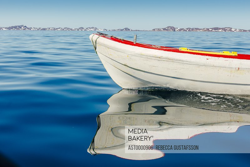 Boat moored in sea