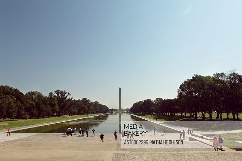Tourists at Lincoln Memorial Park against clear blue sky