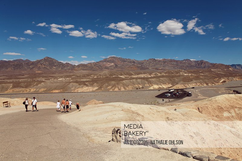 Tourists at Death Valley National Park against blue sky