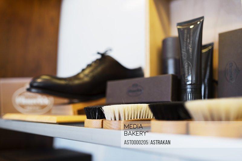 Shoe polish brushes on shelf in showroom