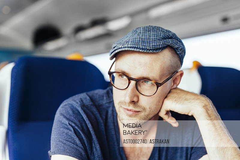 Thoughtful businessman travelling in train