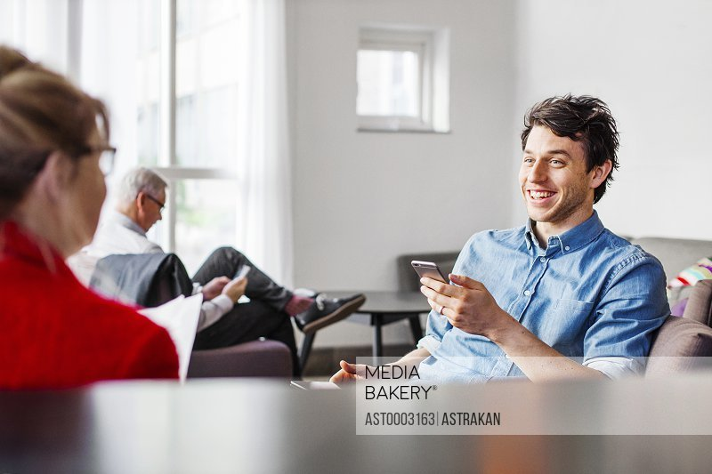 Business people discussing while sitting in restaurant