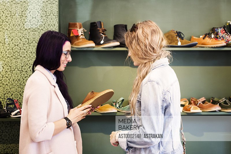 Young women shopping for shoes in a boutique