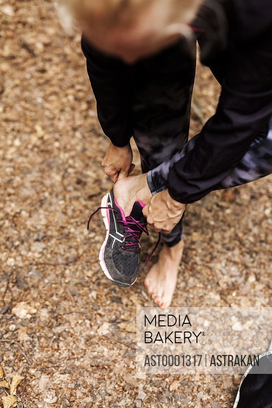 High angle view of woman wearing sports shoe at park