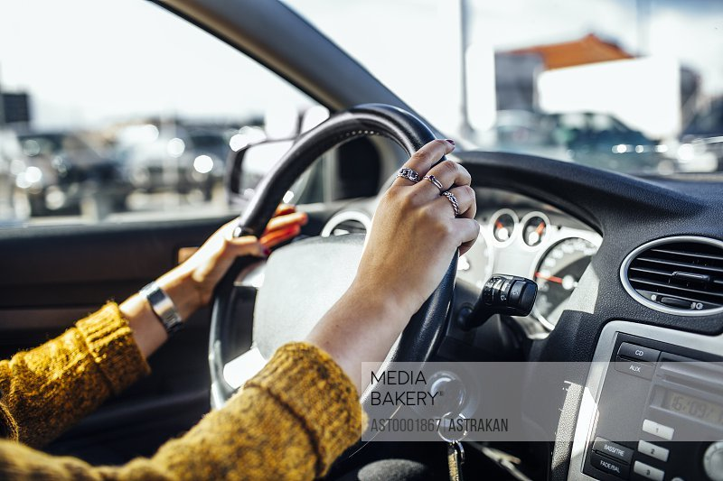 Cropped image of woman driving car