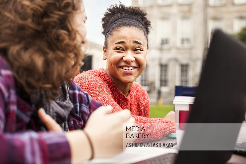 Female student communicating with friend at campus