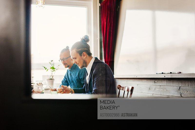 Businessmen working in creative office