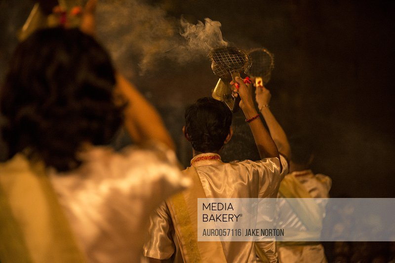 Hindu Priests Burn Incense During Ganga Aarti At Dashaswamedh Ghat, Varanasi, Uttar Pradesh, India<br><br><span style='color: red'>Editorial Use Only.</span><br><br>
