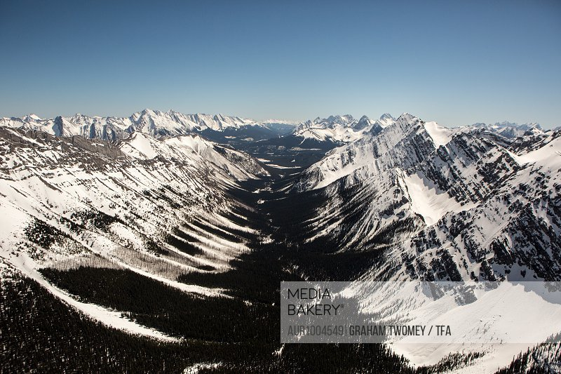 Aerial view over mountains and snow