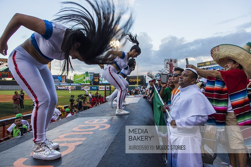 Fans Looking At Women Doing Spandex Dance, Whipping Their Hair On Top Of A Dugout In The Dominican Republic<br><br><span style='color: red'>Editorial Use Only.</span><br><br>