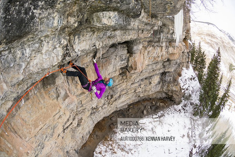 A woman climber becoming the first woman to climb A difficult mixed ice climb called P51 Mustang, rated M14 in the Vail Ampitheater, Vail, Colorado.