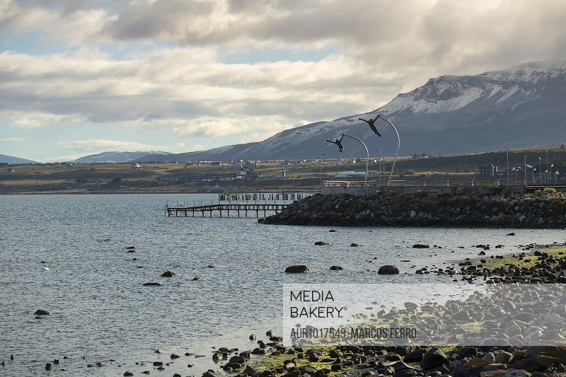 View of coastline with jetties in background, Puerto Natales, Magallanes Region, Chile