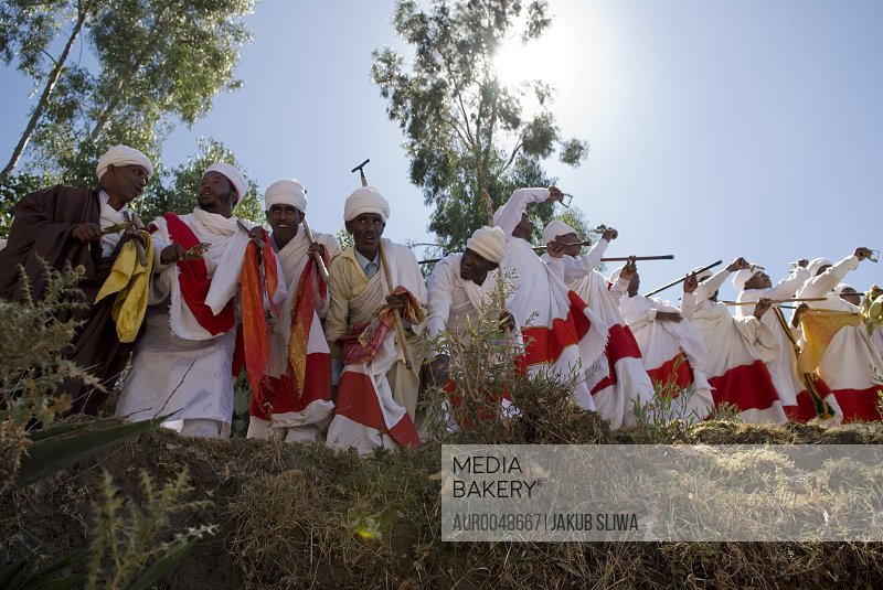 Celebration of Timkat in Lalibela, Ethiopia. Timkat (also Timket or Timqat) is the Ethiopian Orthodox celebration of Epiphany. It is celebrated on January 19 (or 20 on Leap Year), following the Ethiopian calendar. Timkat celebrates the Baptism of Jesus in the Jordan River. This festival is best known for its ritual reenactment of baptism. During the ceremoni<br><br><span style='color: red'>Editorial Use Only.</span><br><br>