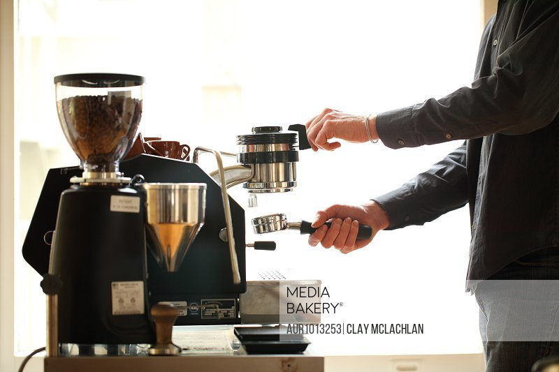 Men preparing coffee, San Francisco, USA