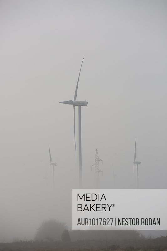 Wind turbines in fog, Burgos, Castile and Leon, Spain