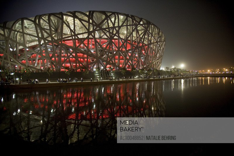 China's New National Stadium also called the Bird's Nest is lit up for an evening event in Beijing. The stadium will be the venue for the opening and closing ceremonies of the Beijing 2008 Summer Olympics, due to kick off on August 8, 2008.<br><br><span style='color: red'>Editorial Use Only.</span><br><br>