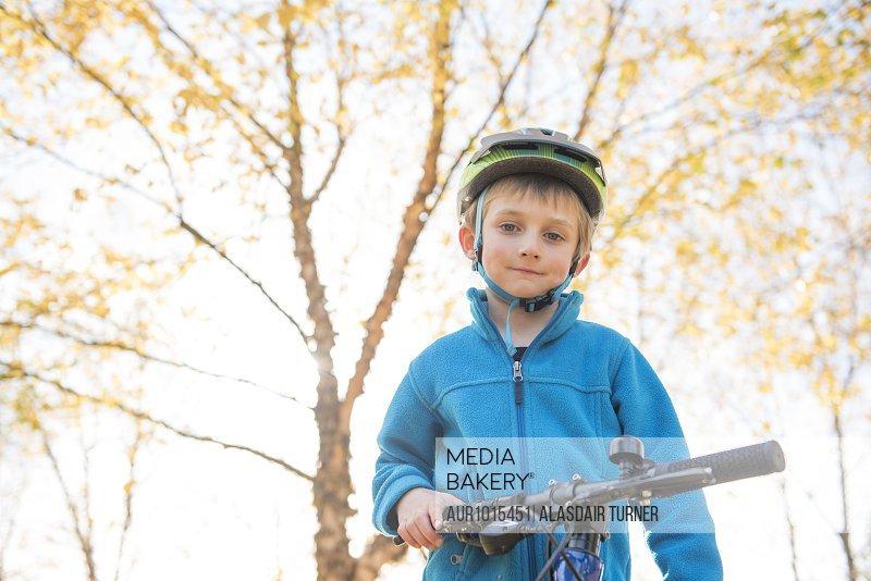 A young boy on a bike.