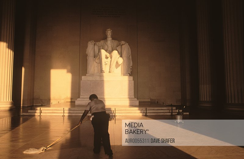 A US Park Ranger mopping the floor of the Lincoln Memorial.