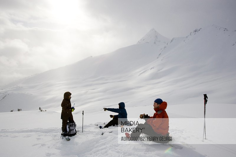 Young adults ski-tour in mountains