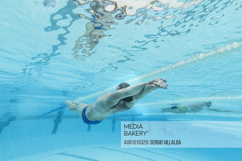 Underwater view of Olympic swimmer training in pool, Tenerife, Canary Islands, Spain