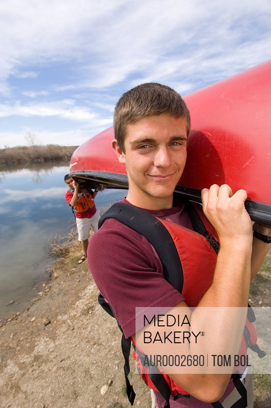 Portrait of teenage boy canoeing.
