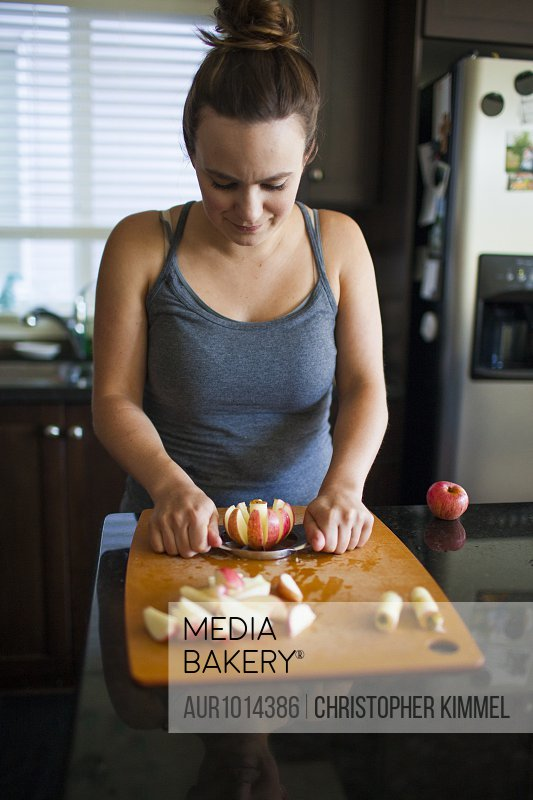 Woman slicing apple with apple slicer