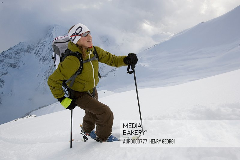 Young woman ski-touring in mountains
