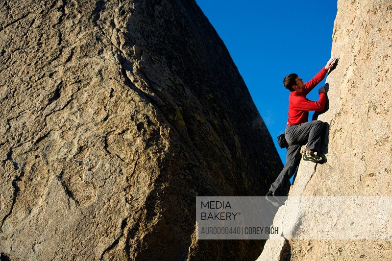 Male climber bouldering.