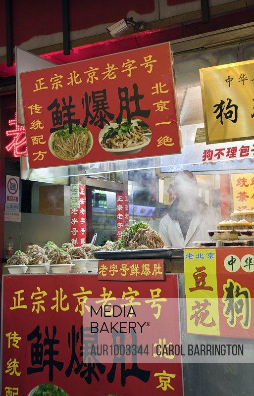 Take-away noodle stand at night market, Beijing, China
