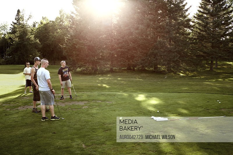 Friends; Dylan Tisor, Hank Poulin, Keegan, and Robert Rivers size up their putts on the First hole of the Moose Meadows golf course.<br><br><span style='color: red'>Editorial Use Only.</span><br><br>