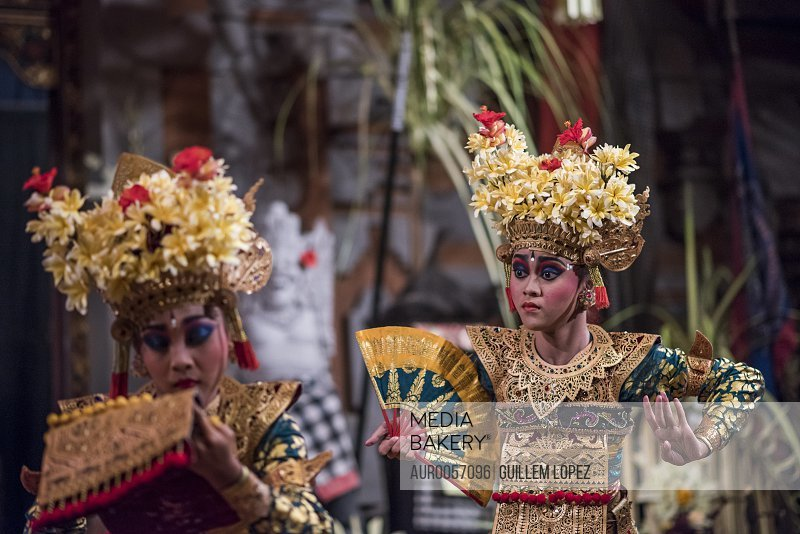 Traditional Balinese Legong dancers performing in a theater in Ubud, Bali, Indonesia.<br><br><span style='color: red'>Editorial Use Only.</span><br><br>