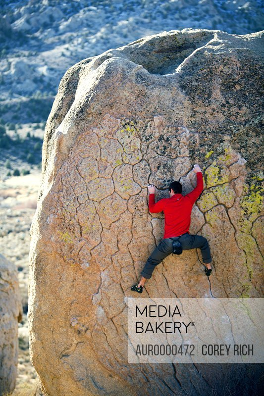 Man bouldering on an overhang