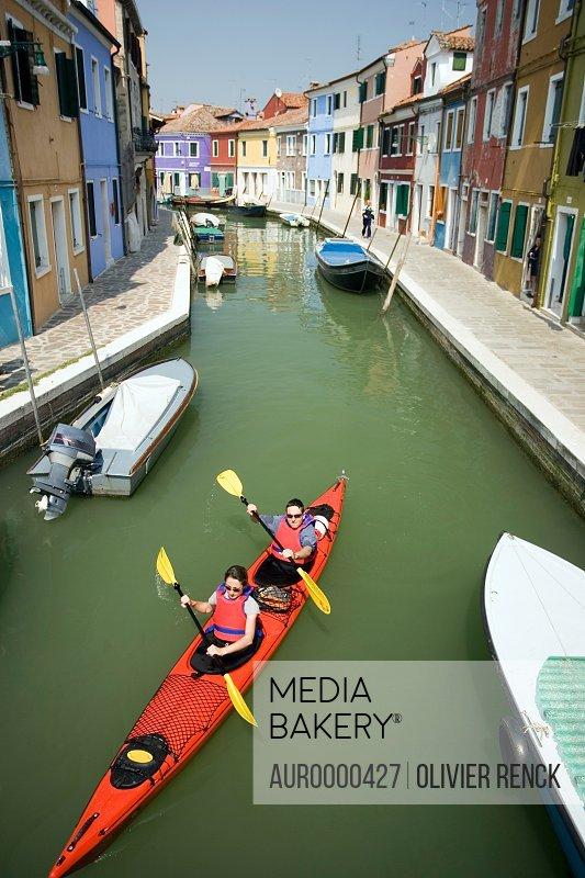 A couple sea kayak in Venice, Italy.
