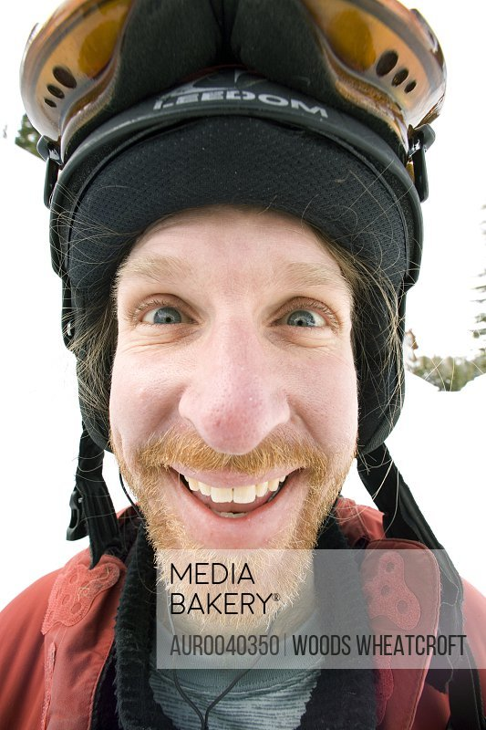 Chef Paul Donaghue poses for a goofy portrait after a day of skiing at Schweitzer Mountain Resort.  Wide angle shot makes his nose look huge and his eyes crossed.