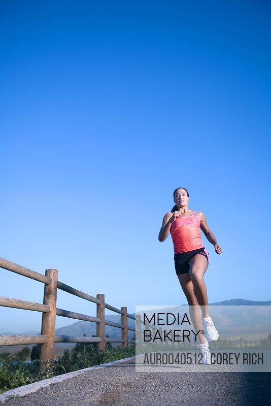 Brenda Taylor running on a dirt path in San Diego, California.