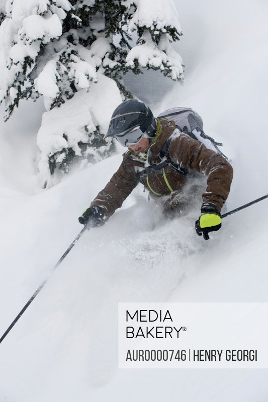 Young woman skiing in deep powder
