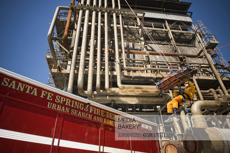 Firefighter Alan Baker and victim Sean Escontrias practice Industrial Search and Rescue at an abandoned oil refinery in Santa Fe Springs, California on March 11, 2008.