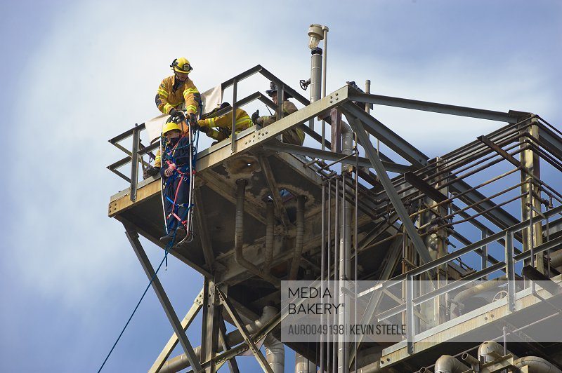 Matt Newbill (stretcher), Mike Yule, Eddie Nilo and Alan Baker (left to right) practice Industrial Search and Rescue at an abandoned oil refinery in Santa Fe Springs, California on March 11, 2008.