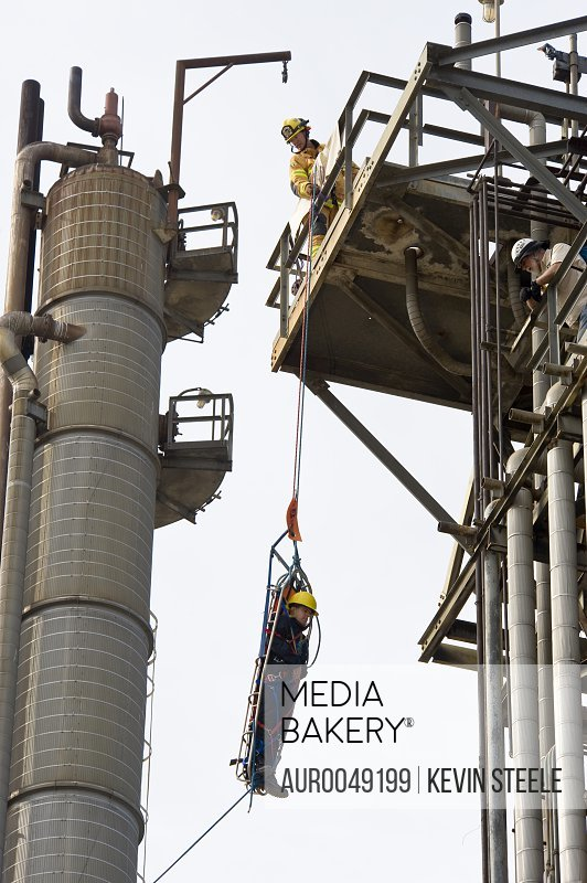 Matt Newbill (stretcher), Mike Yule and Alan Baker (left to right) practice Industrial Search and Rescue at an abandoned oil refinery in Santa Fe Springs, California on March 11, 2008.