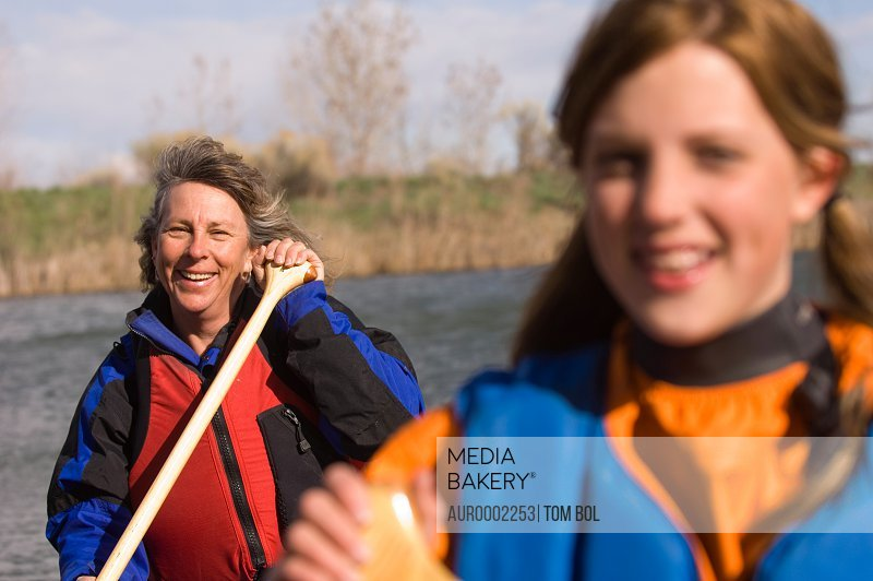 A mother and daughter canoeing