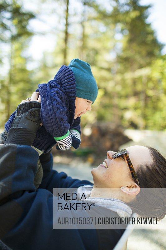 Mother holding baby aloft