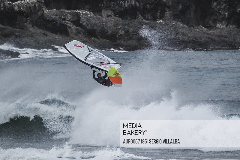 Professional Windsurfer In The Freezing Water Of The Faroe Islands<br><br><span style='color: red'>Editorial Use Only.</span><br><br>
