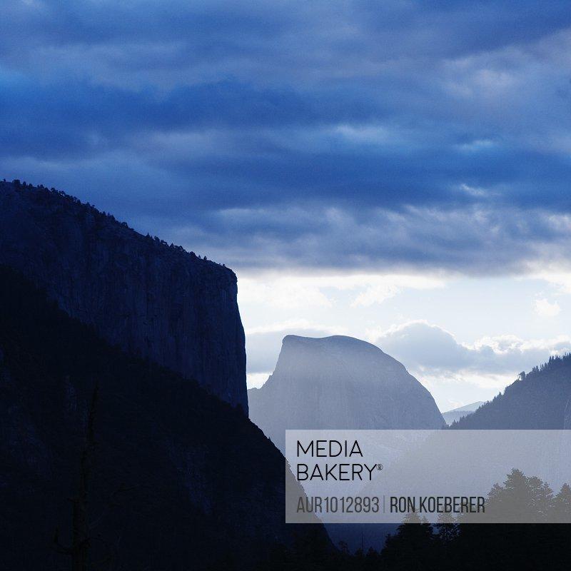 El Capitan and Half Dome in silhouette.