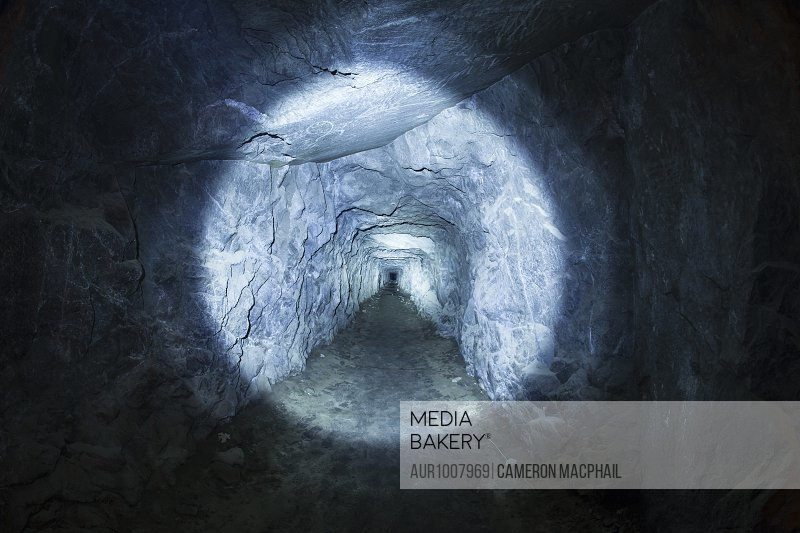 Photograph of tunnel in cave illuminated by flashlight, Inspiration Point, Yosemite National Park, California, USA