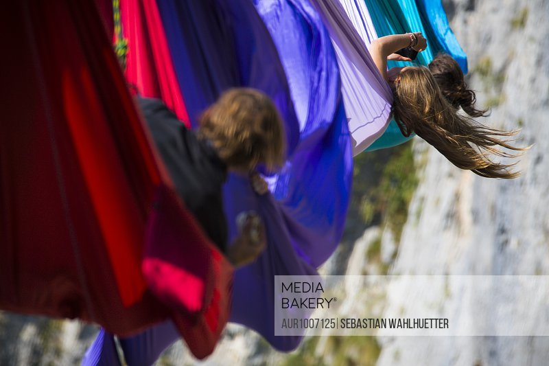 People lying in hammocks and hanging on high line above mountains, Tijesno Canyon, Banja Luka, Bosnia and Herzegovina<br><br><span style='color: red'>Editorial Use Only.</span><br><br>