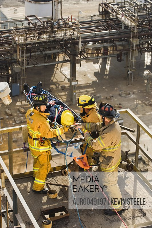 Matt Newbill (stretcher), Eddie Nilo ,Mike Yule and Alan Baker (left to right) practice Industrial Search and Rescue at an abandoned oil refinery in Santa Fe Springs, California on March 11, 2008.