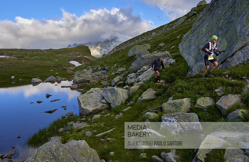 People running on hills during daytime, Alpe Devero, Verbania, Italy