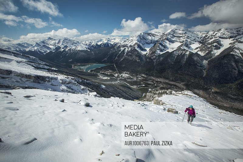 Person climbing on mountains in snow, Mount Lawrence, Canmore, Alberta, Canada