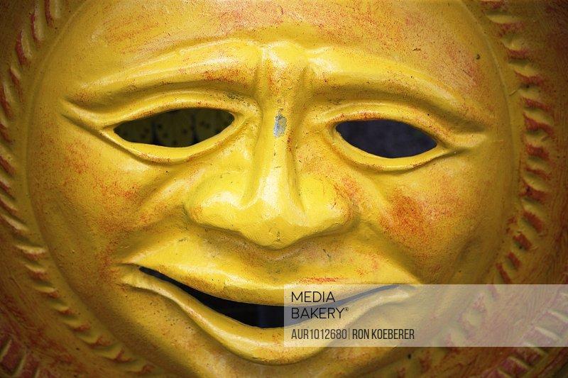A plaster mask sculpture.